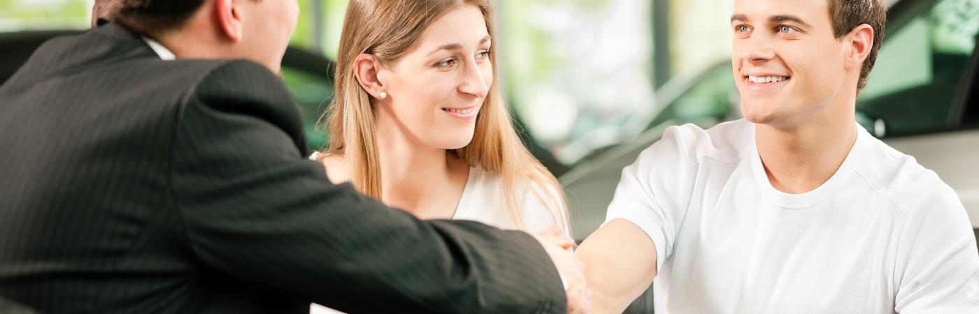 couple meeting with car salesman