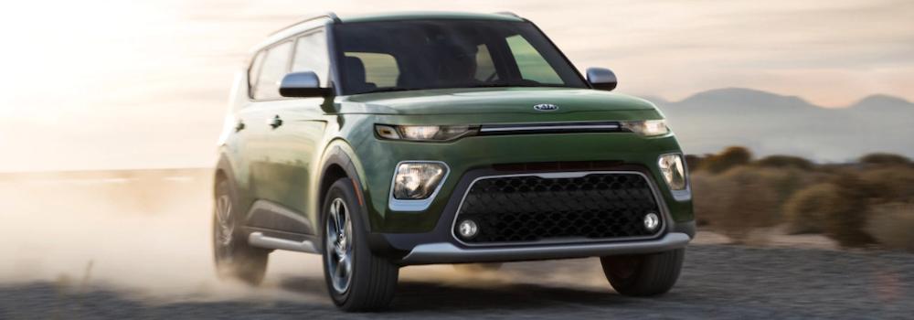 2020 Kia Soul driving on a dirt road