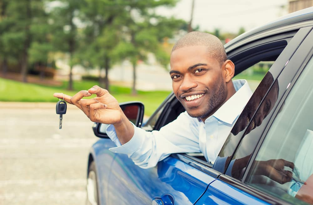 Man with new car keys