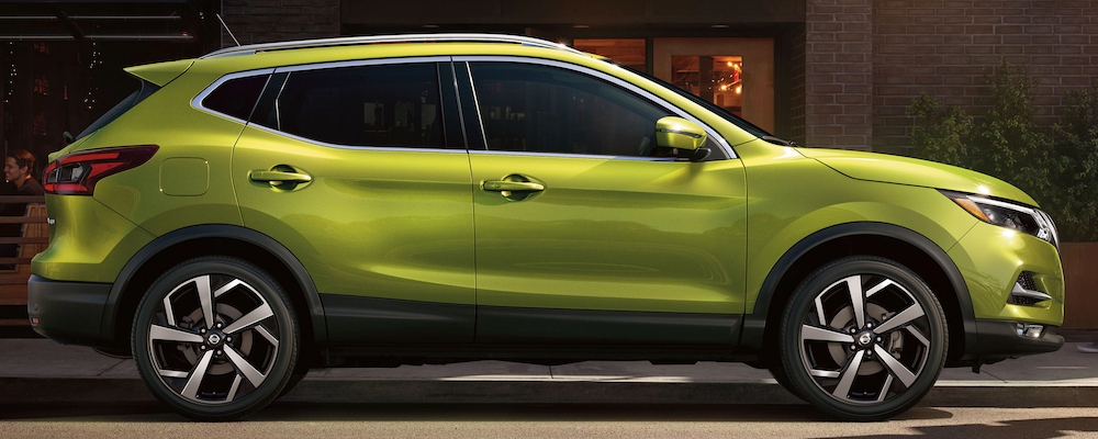 Green 2020 Nissan Rogue Sport in profile