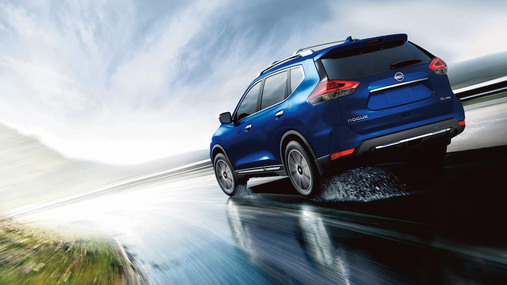 2020 Nissan Rogue on a wet road