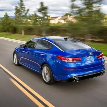 2019-Kia-Optima-rear-driving