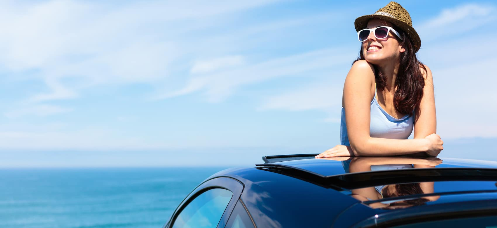 Woman leaning out of a sunroof