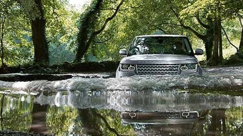 Land Rover Range Rover driving through water