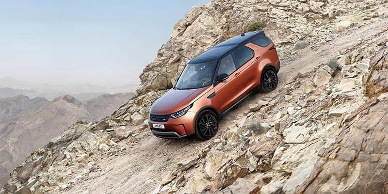 2019 Land Rover Discovery Off-Roading Down a Rocky Mountain Hill