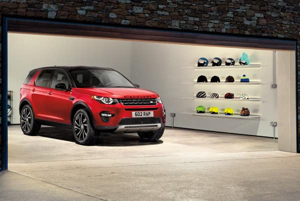 2019 Land Rover Discovery Sport SE - Red exterior parked in a garage