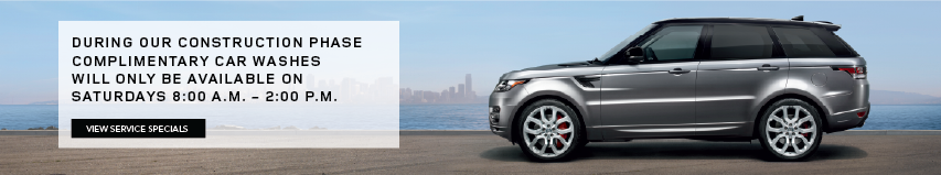 RANGE ROVER SPORT PARKED ON CONCRETE NEXT TO WATER WITH BLUE SKIES AND CITY VIEW IN BACKGROUND. DURING OUR CONSTRUCTION PHASE, COMPLIMENTARY CAR WASHES WILL ONLY BE AVAILABLE ON SATURDAYS 8:00 AM. UNTIL 2:00 PM. VIEW SERVICE SPECIALS.