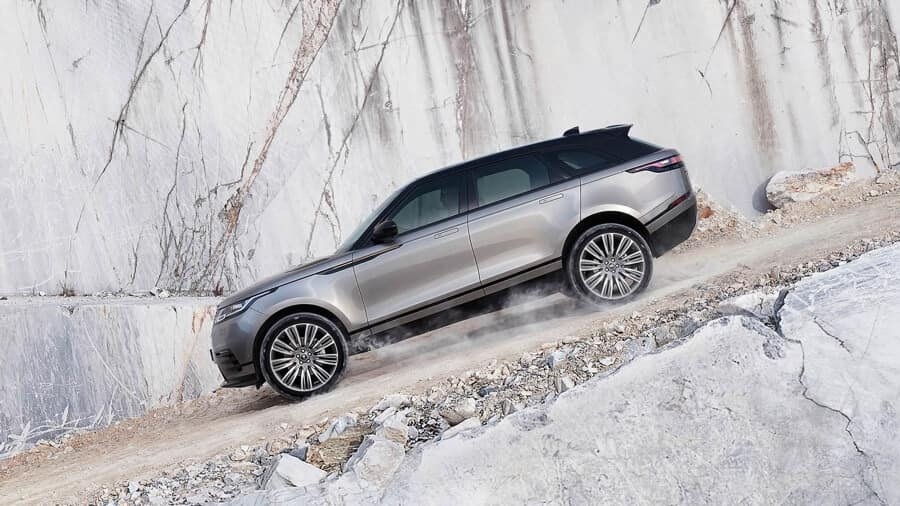 2018 Range Rover Velar driving down a gravel hill