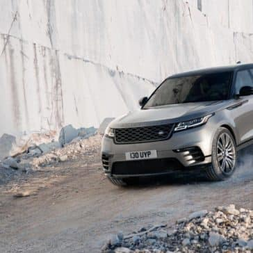2019 Land Rover Range Rover Velar Driving Down Rocky Mountain Hill