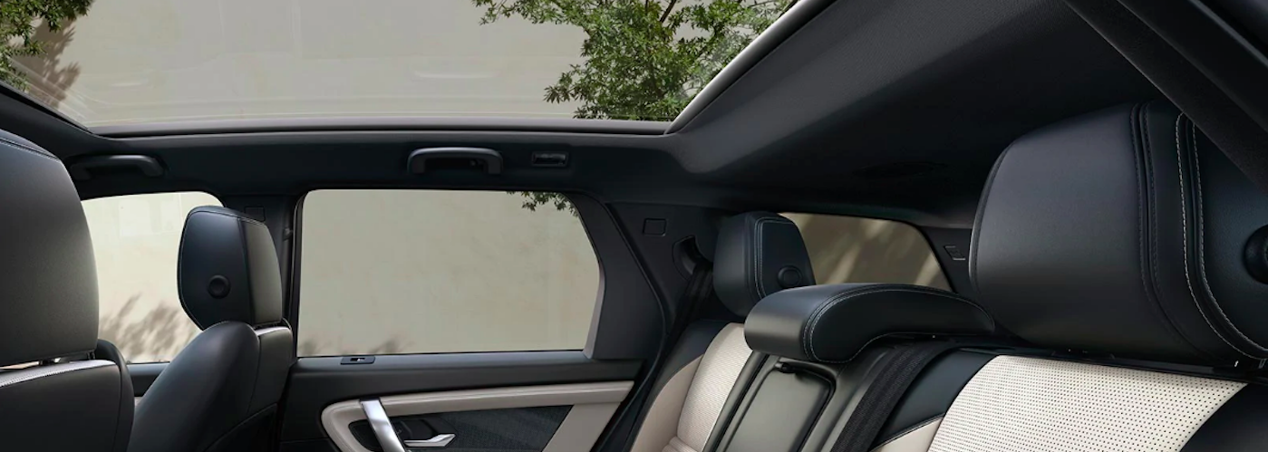 Looking up at panoramic roof from inside Land Rover Discovery Sport