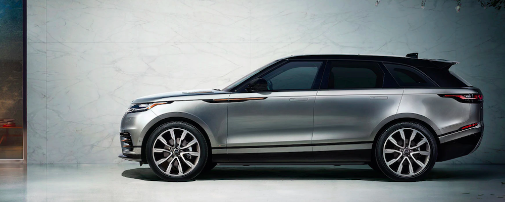 2020 Range Rover Velar parked alongside gray wall
