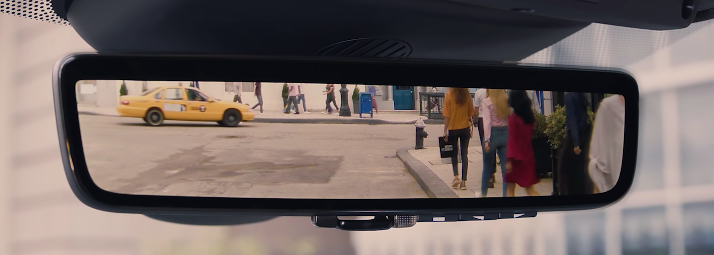 Land Rover Clearsight Rear-View Mirror showing people and cars traveling behind vehicle