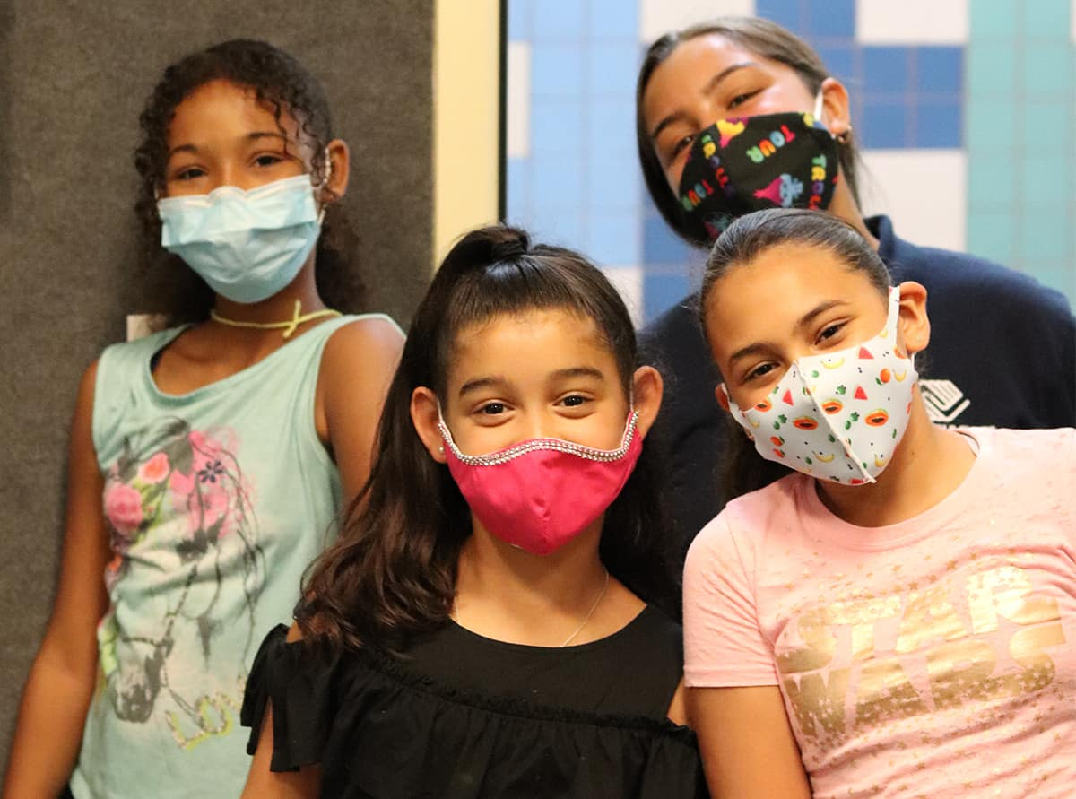 Four masked girls from Boys and Girls Club