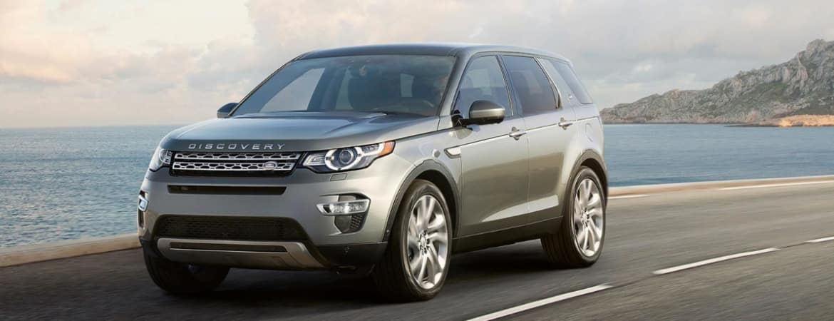 The 2019 Land Rover Discovery Sport driving down the street.