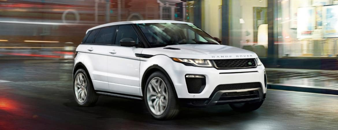 White 2019 Range Rover Evoque driving through city