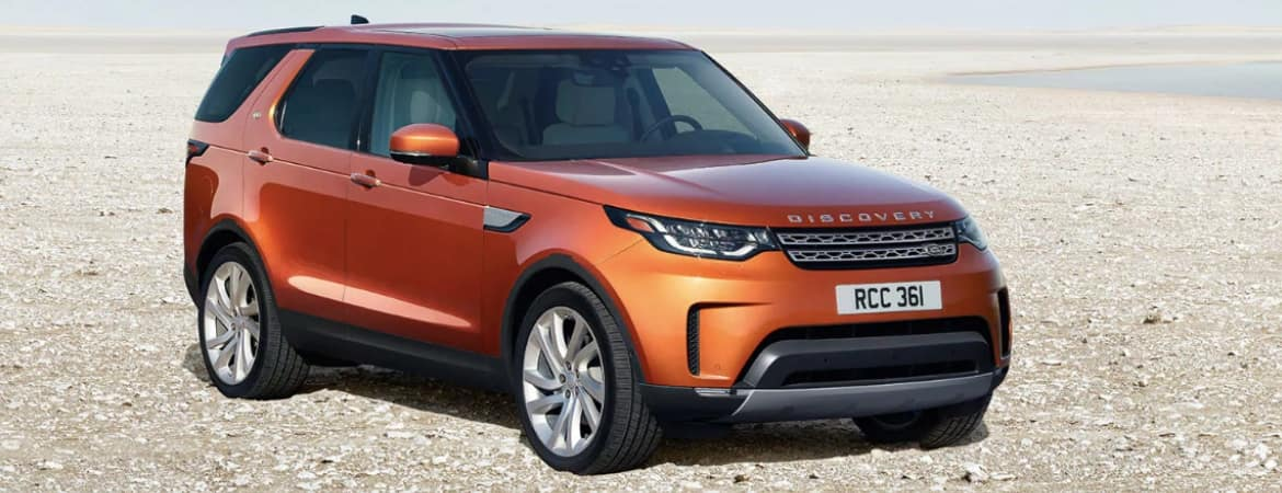 Orange 2019 Land Rover Discovery parked in desert