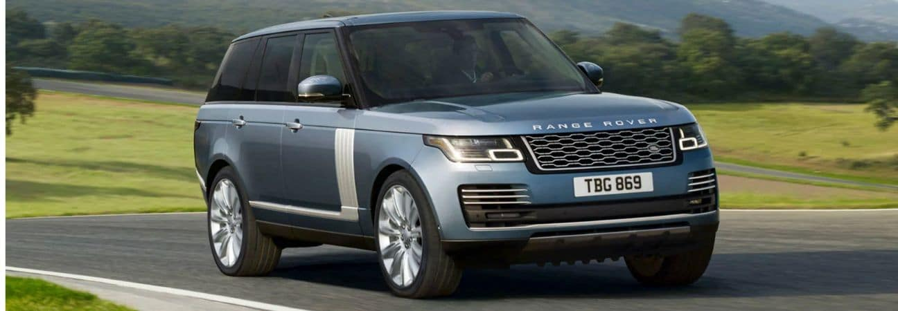 2020 range rover driving through the country side