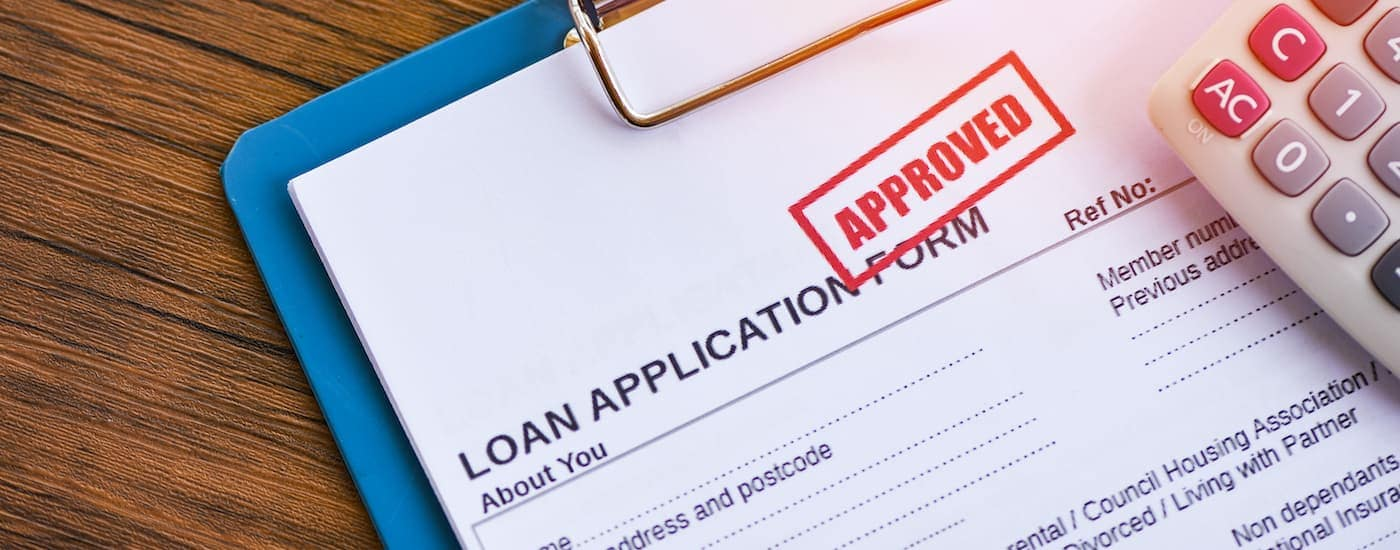 An approved loan application is shown on a desk at a buy here pay here in Cincinnati.