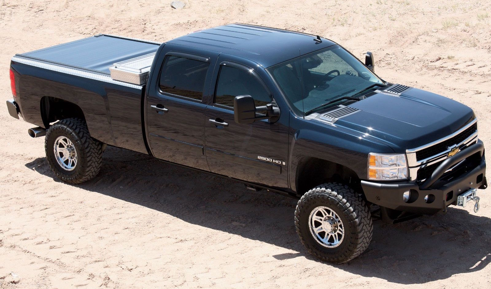 Lifted Black 2007 Used Chevy Silverado 2500HD from above in a sand put