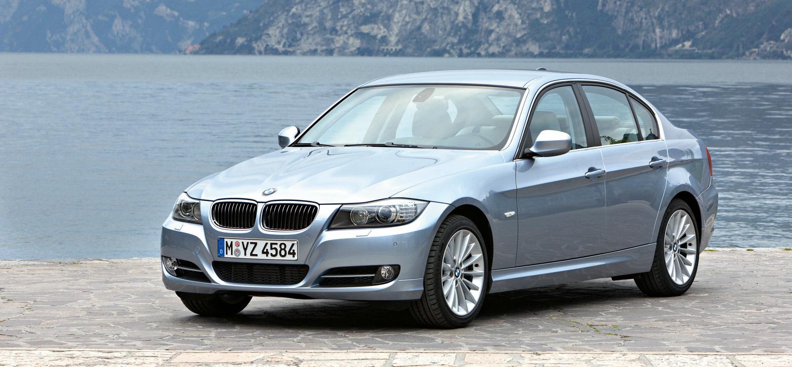 Blue 2009 Used BMW 3-Series next to mountain lake