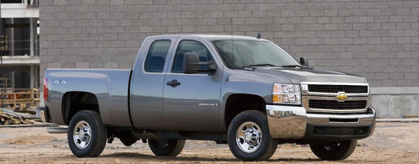 A silver 2009 Used Chevy Silverado is at construction site.