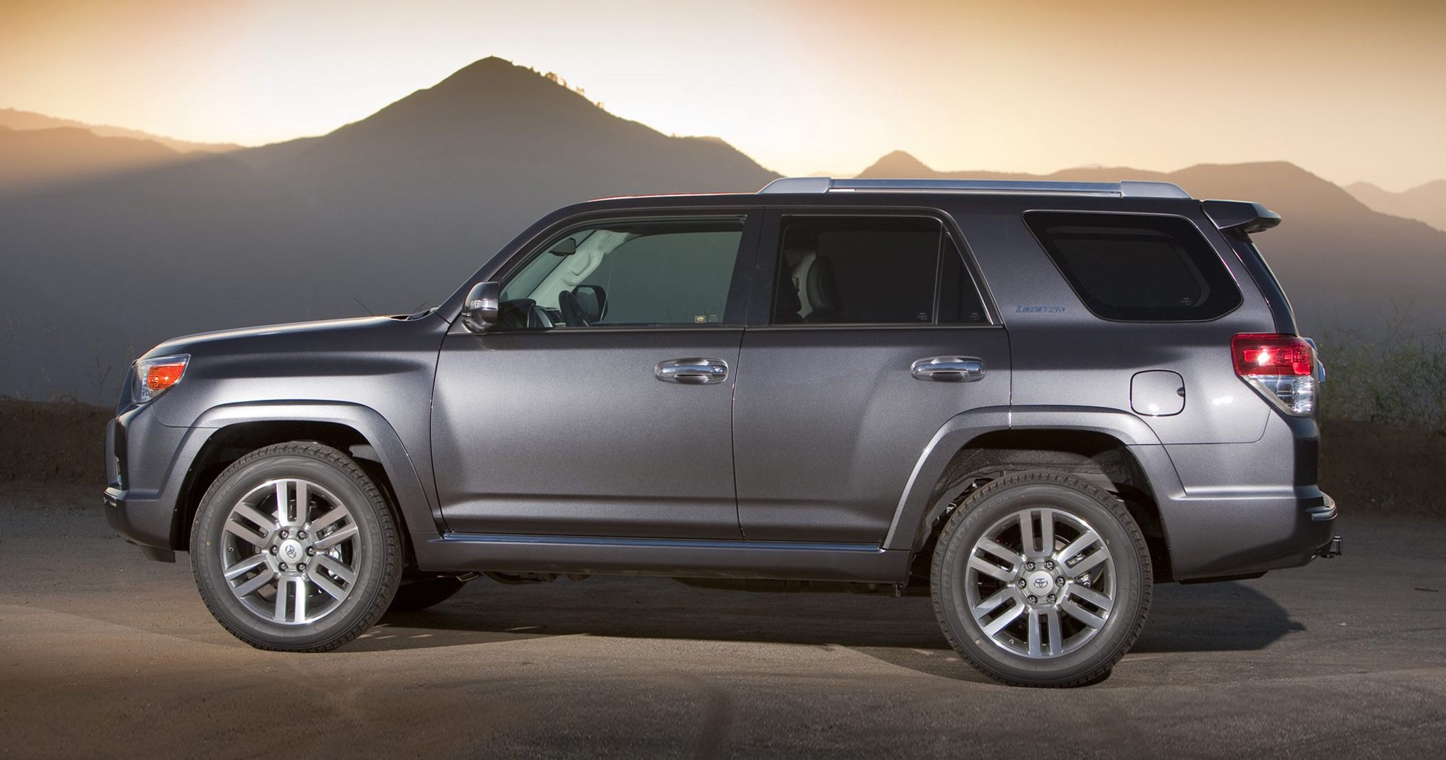 Gray 2011 Used Toyota 4Runner parked in front of mountains at sunset