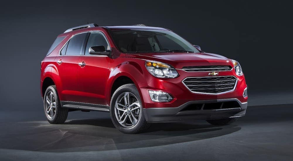 A red 2016 used Chevy Equinox LTZ is parked on a dark gray background.