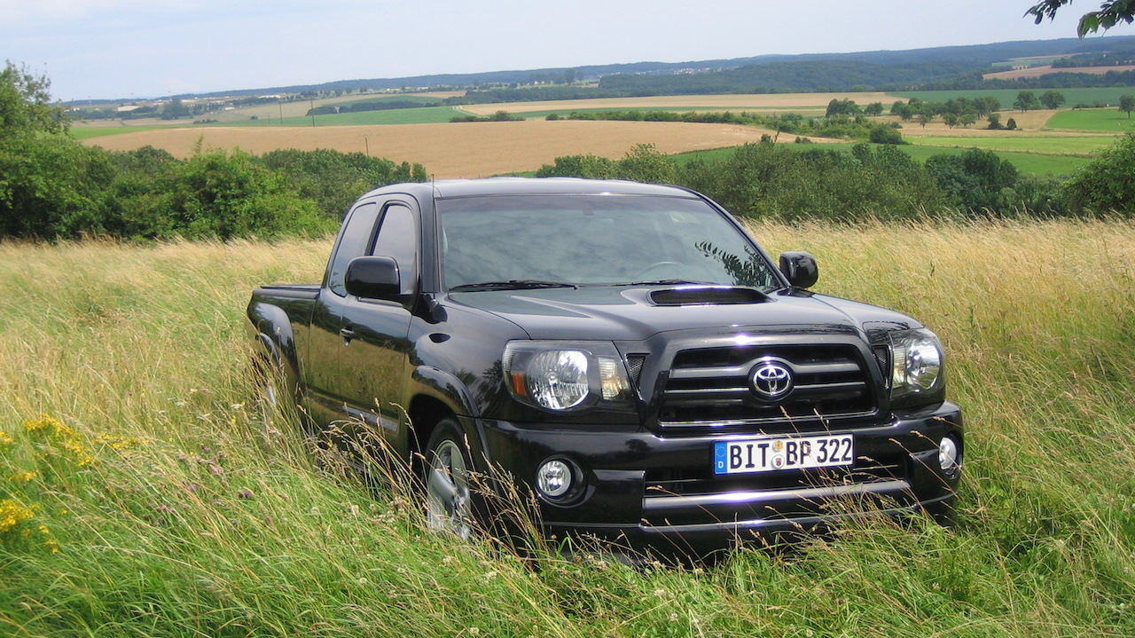 Black 2006 Used Toyota Tacoma in a grassy field