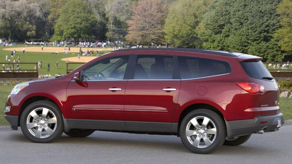 A red 2010 used Chevy Traverse is at the park near Cincinnati, OH.