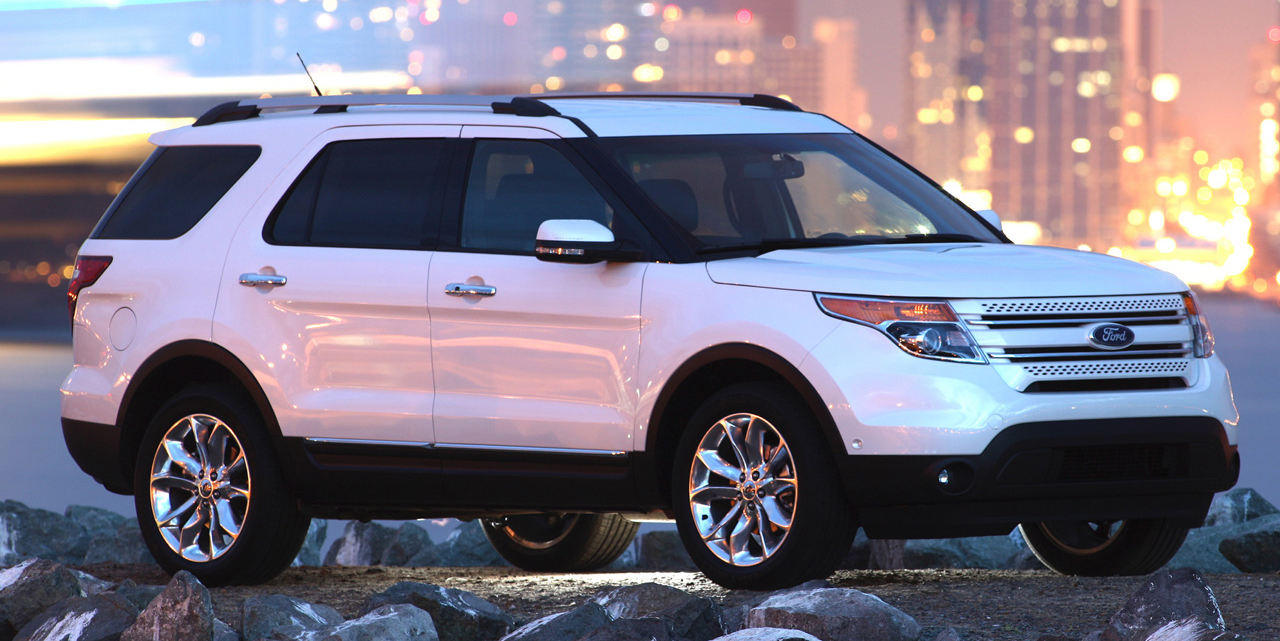 White 2011 Used Ford Explorer parked in front of scenic building at night