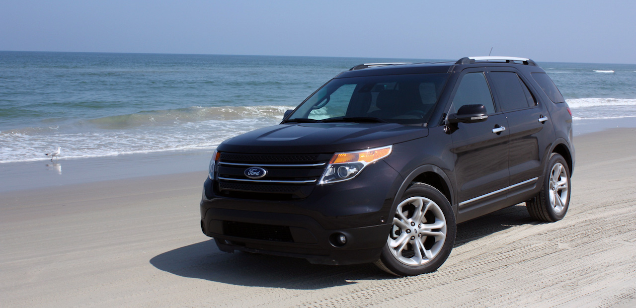 Blue 2012 Used Ford Explorer driving down the beach