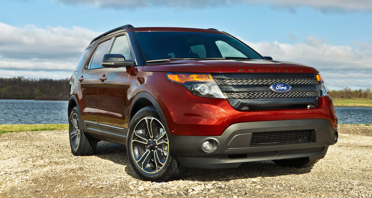 Red 2015 Used Ford Explorer on a beach