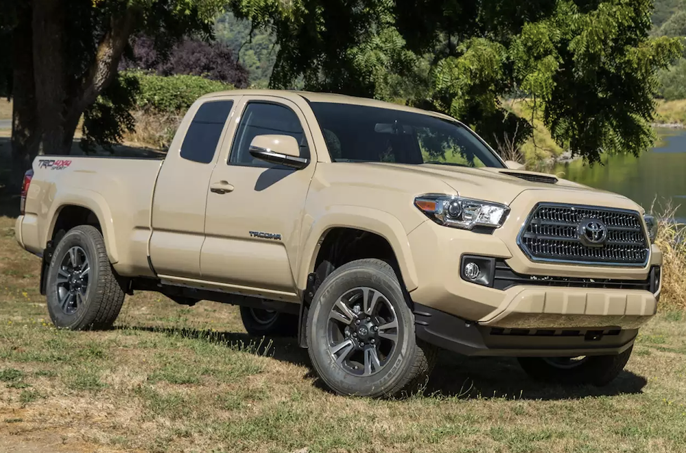 Tan 2016 Used Toyota Tacoma parked next to a pond