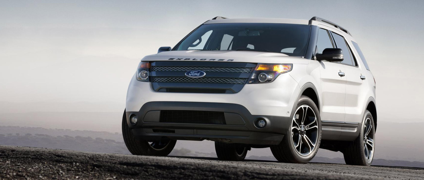 2014 White Used Ford Explorer atop a hill against a gray sky