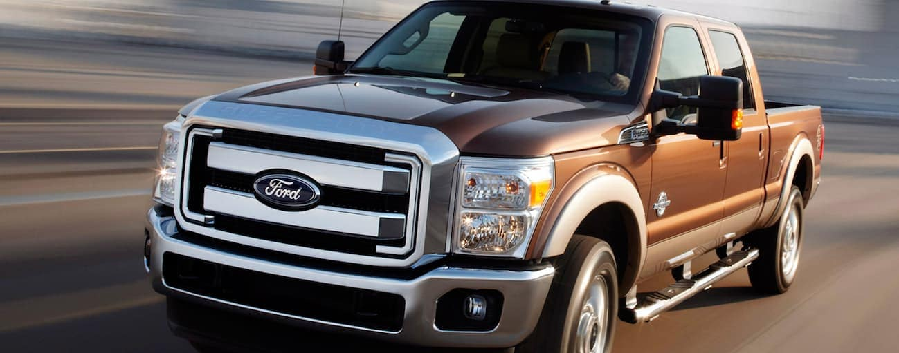 A brown 2012 Ford F-250 is driving on a highway near Cincinnati, OH.