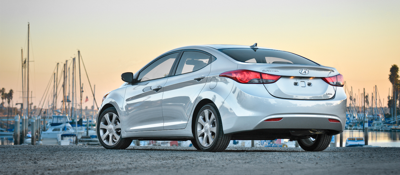 Silver 2012 Used Hyundai Elantra at a marina at sunset