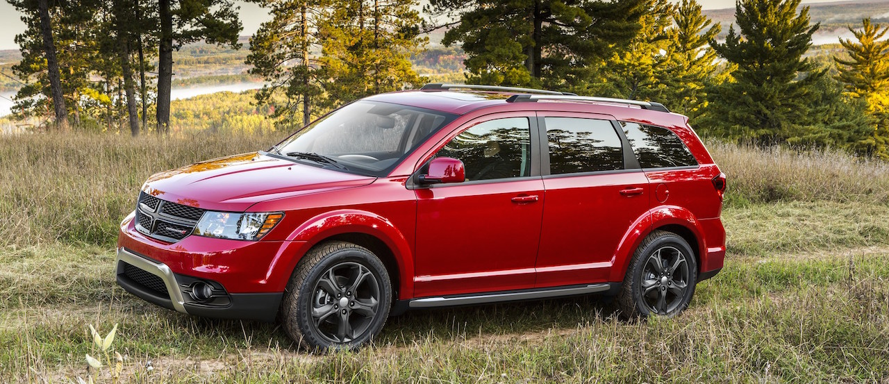 Red 2015 Used Dodge Journey Crossroad climbing a grassy trail