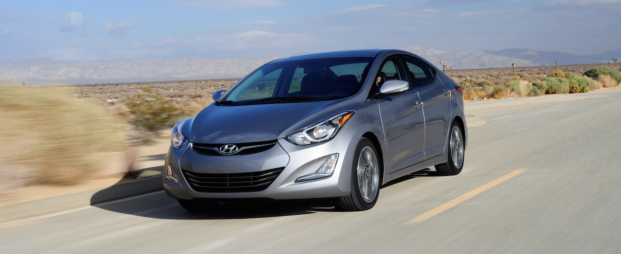 Silver 2015 Used Hyundai Elantra Sedan driving in desert