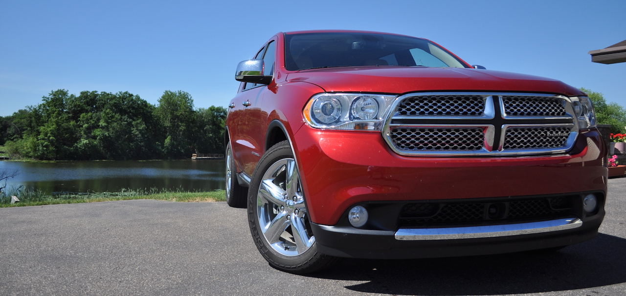 Red 2011 Used Dodge Durango from the front in front of a lake