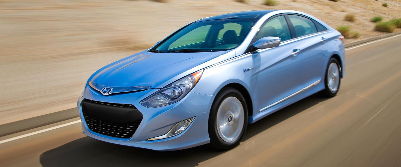 Silver 2013 Used Hyundai Sonata driving fast on a desert road