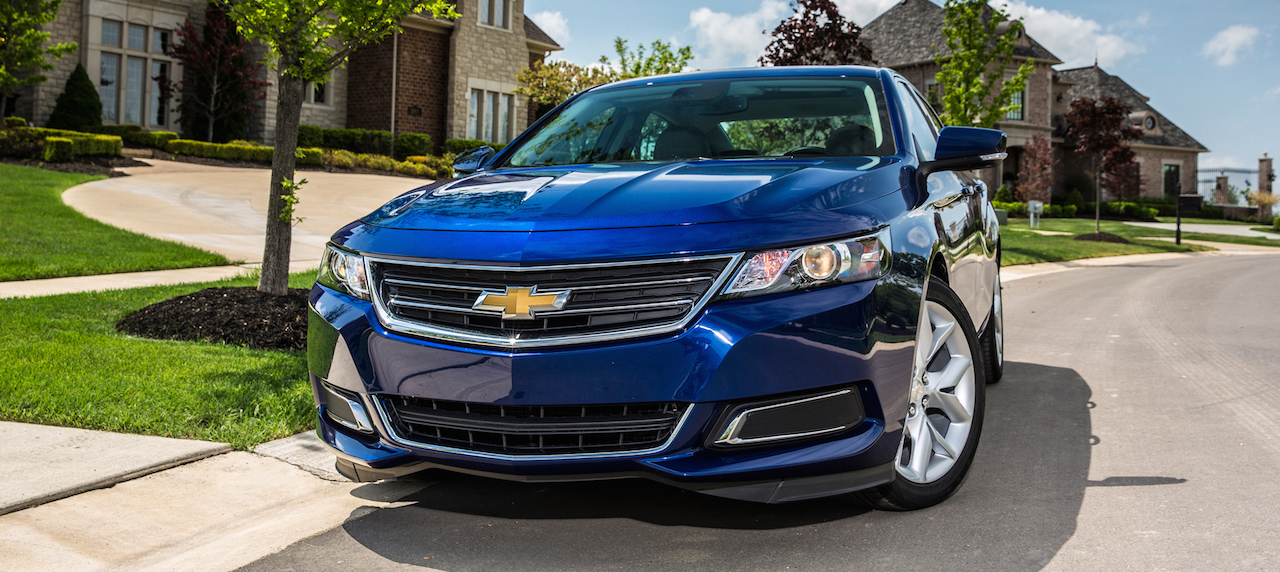 Blue 2016 Used Chevy Impala from the front on a suburban street