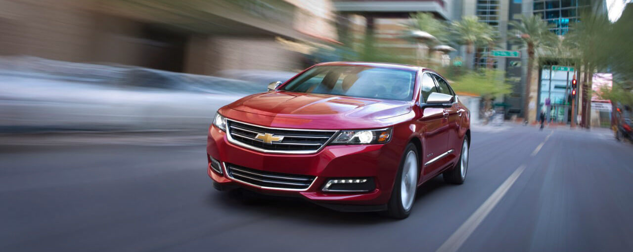 Red 2017 used Chevy Impala from the driving on a city street