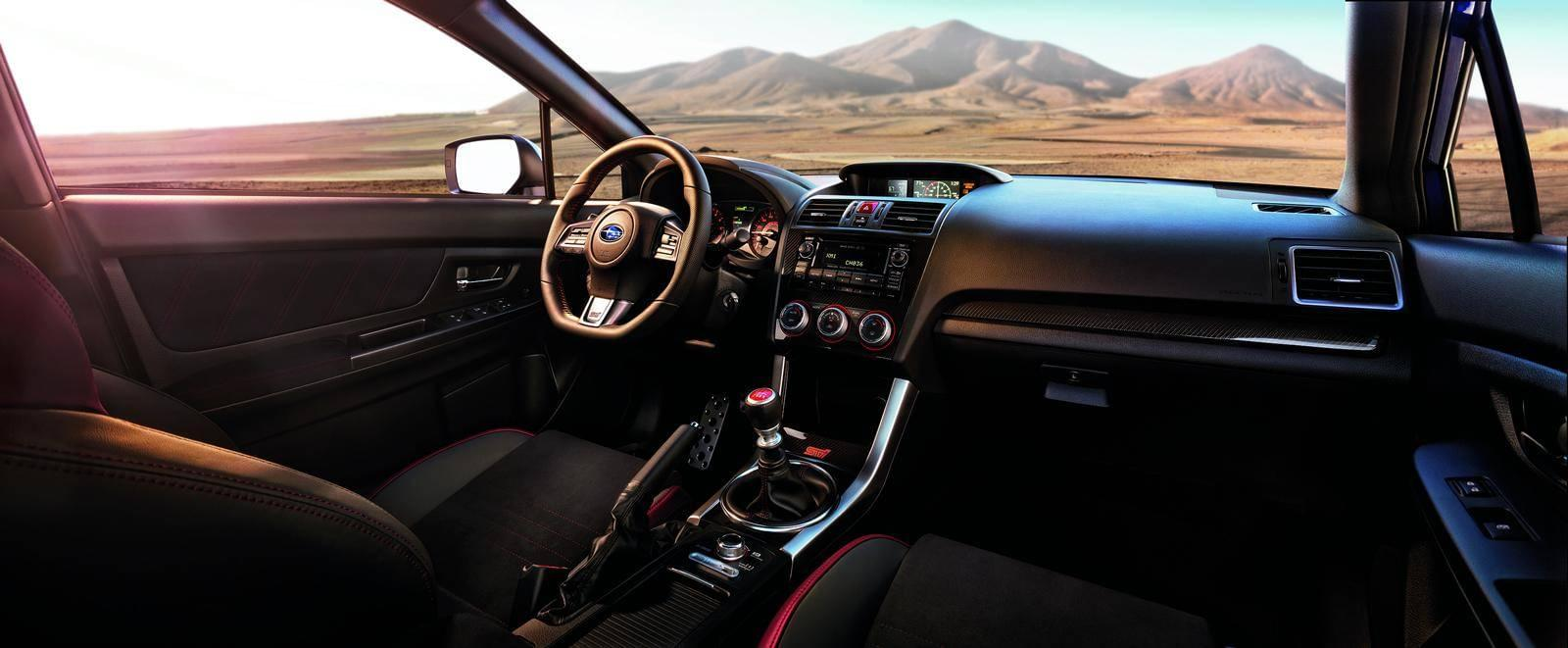 Interior view of 2015 Used Subaru STI overlooking plains and mountains