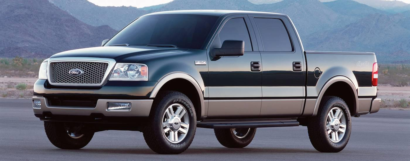 Black 2004 Used Ford F-150 Lariat with mountains in back