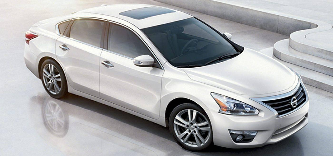 A white 2014 Used Nissan Altima from above in front of marble stairs