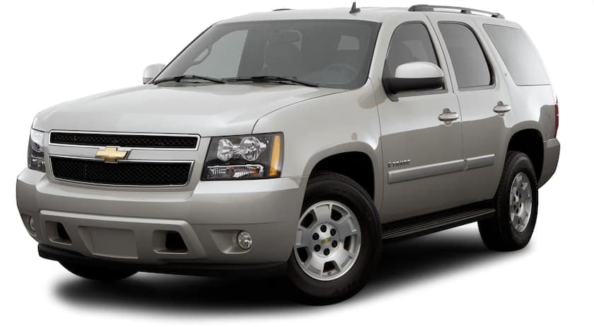 A silver 2009 used Chevy Tahoe is angled left on a white background.