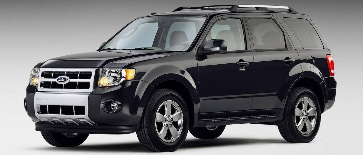 Black 2009 Used Ford Escape angled left on gray background