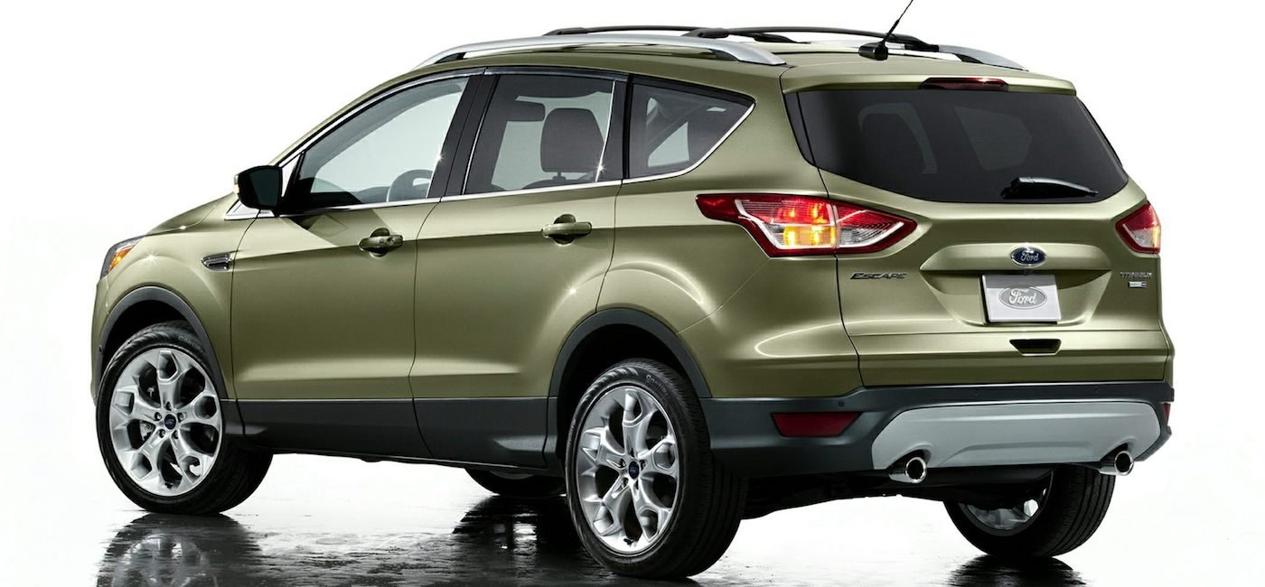 Light Green 2016 Used Ford Escape angled away on white background