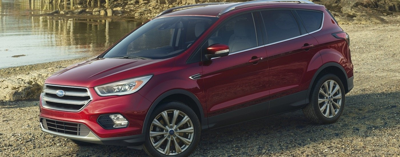 Red 2017 Used Ford Escape next to a pond
