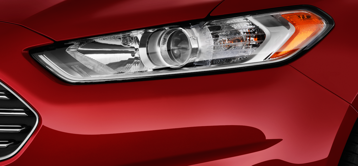Closeup of a Red 2016 Used Ford Fusion headlight